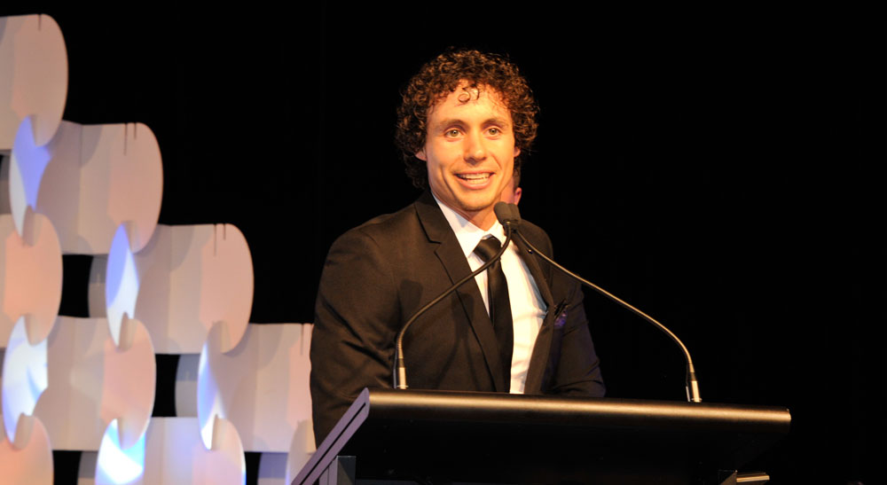 James George director of award winning custom home builder HIghlife Homes accapts the Rising Star Builder award at the Queensland Master Builders Awards