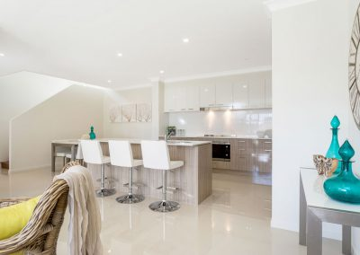 Kitchen and dining in duplex in Palm Beach QLD