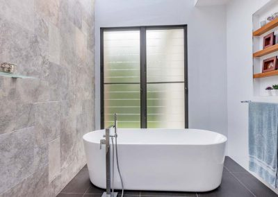 Ensuite with freestanding bath and stone feature wall