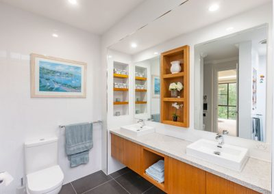 Bathroom with timber cabinetry, stone benchtop and double vanity