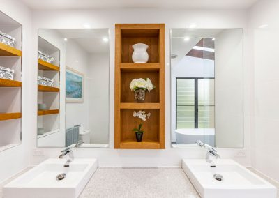 Double vanity and timber niche in bathroom