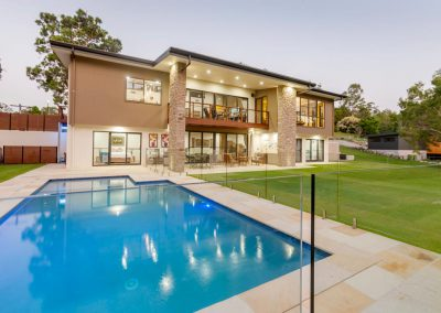 Large two storey luxury home with a large swimming pool