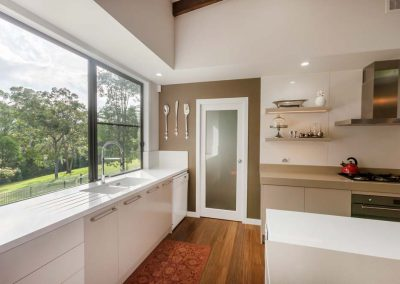 Luxurious kitchen with window to the hinterland