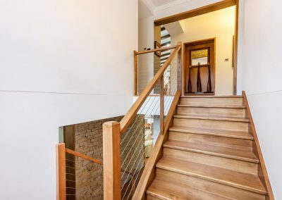 Stair way in luxury home built by Highlife Homes