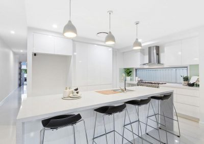 Fresh white kitchen of a luxury duplex built by Highlife Homes