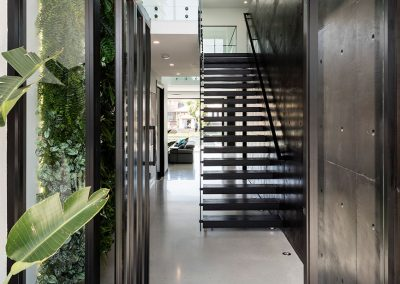 Modern Home Entryway with Black and Glass Features